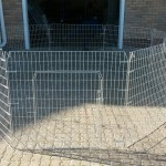 Meduim add-on panels joined to form an octagon pen with gate.